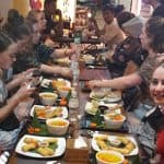 Guests Eating Cambodian Dishes